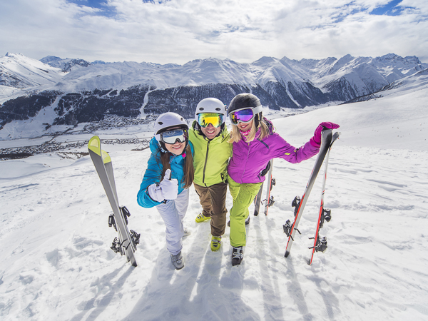 Happy skiers on holiday