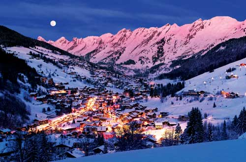 Night Time Skiing and Snowboarding Under the Full Moon in La Clusaz