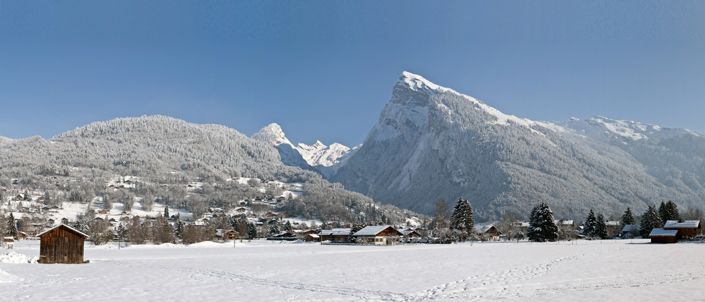 Snow-covered Alpine village surrounded by mountains