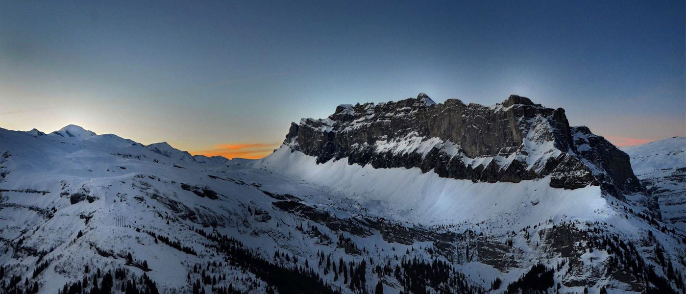 Snowy mountains at sunset in a ski resort