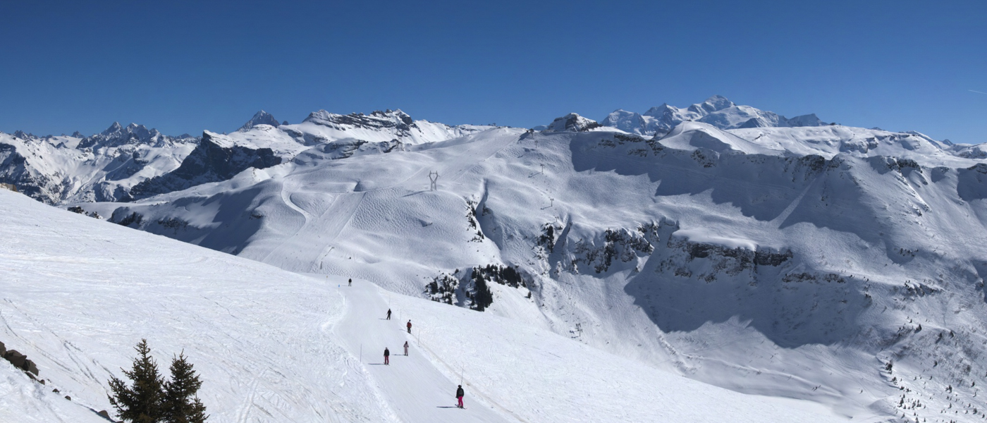 Snowy mountains and blue ski in a ski resort