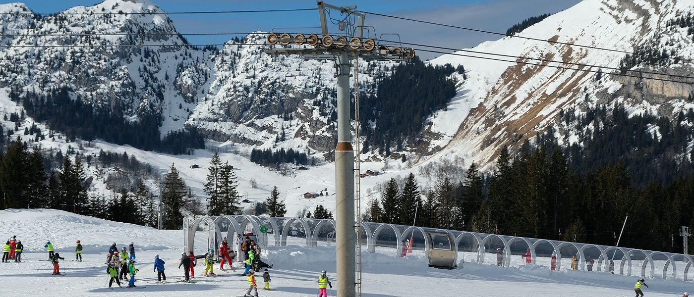 Magic carpet ski lift in snowy ski resort