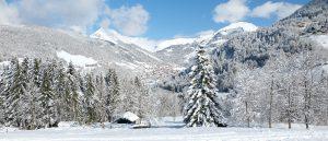 Snowy mountain scene across Le Grand Bornand village