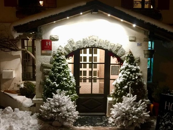 Snowy hotel entrance at night
