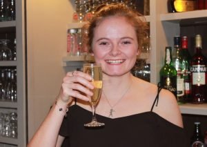 Happy girl with champagne in a bar