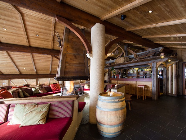 cosy hotel lounge and bar overlooking snowy mountains