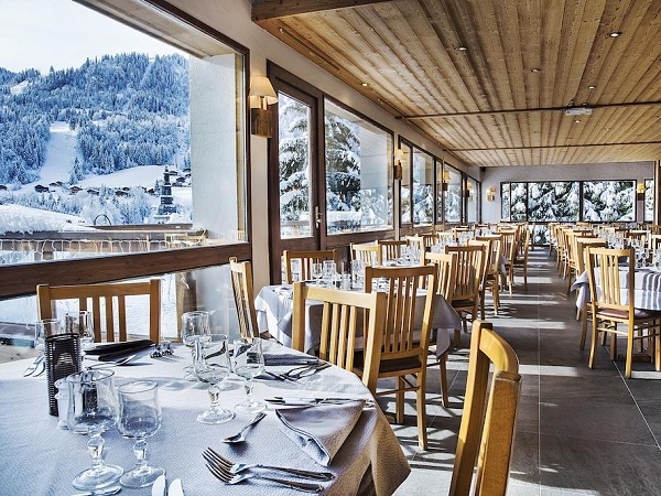 Hotel Alpen Roc dining room with mountain views